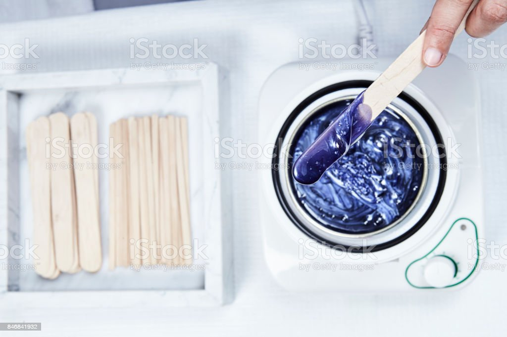 Hot wax application for hair removal stock photo