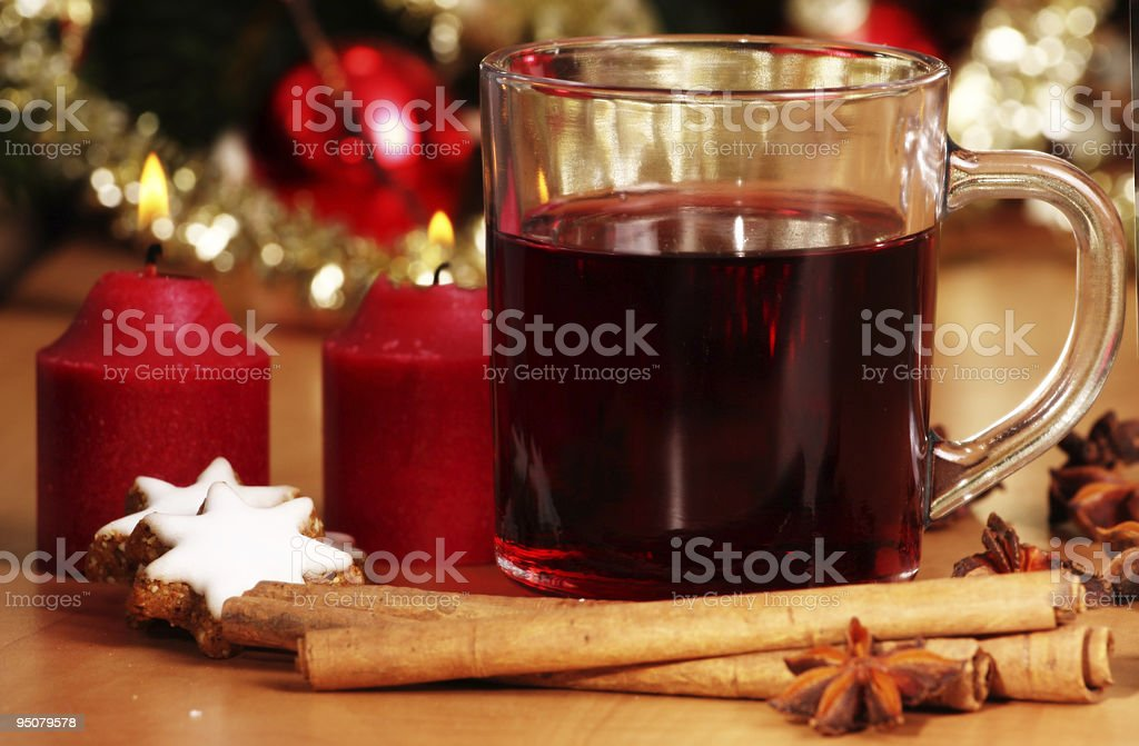 hot wine punch, star anise and candles  - xmas royalty-free stock photo