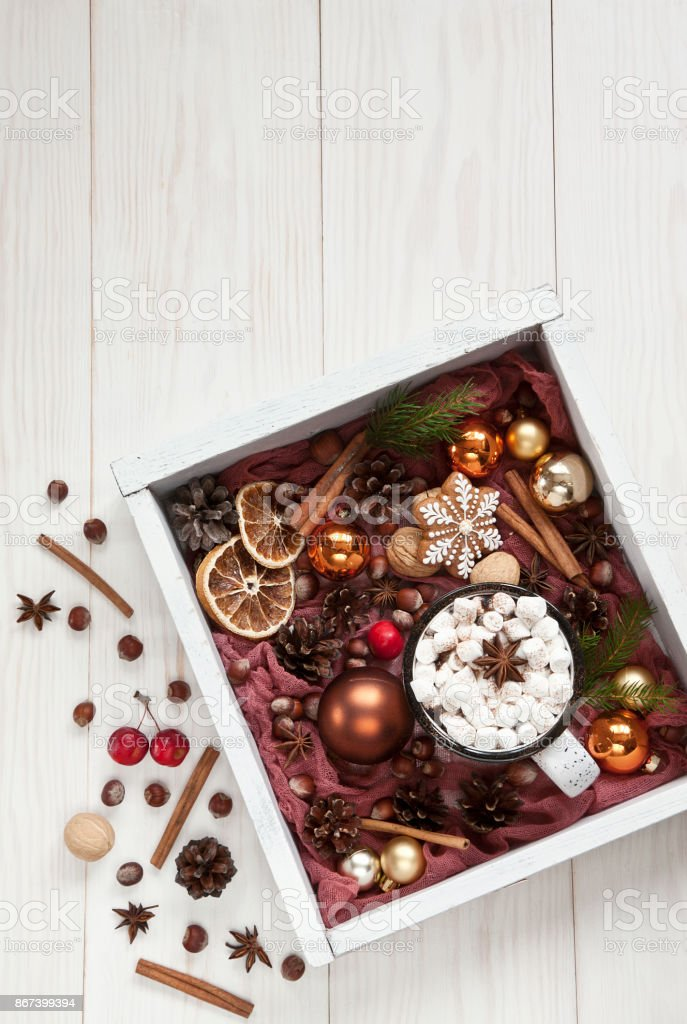 Hot winter drink with marshmallow, gingerbread and nuts. stock photo