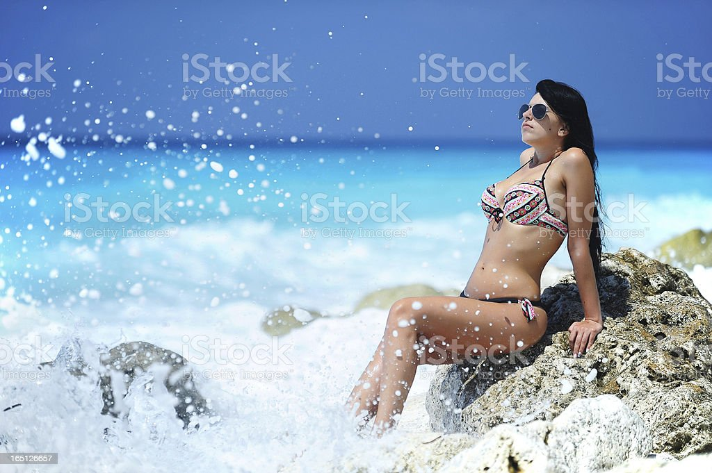 Hot woman on a beach royalty-free stock photo