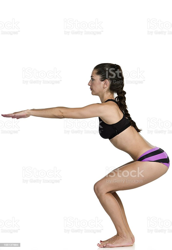 Hot Yoga Awkward pose (Utkatasana) royalty-free stock photo