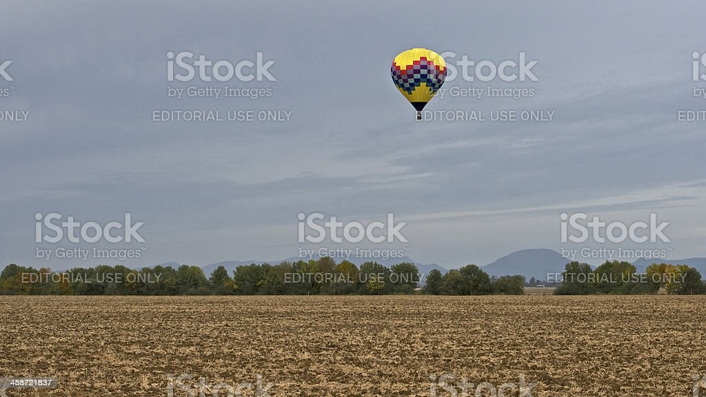 Hot-Air Balloon Flying Above Field Albany Oregon Art air Festival royalty-free stock photo