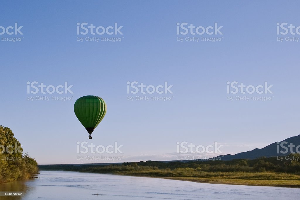 Hot-air balloon over the water stock photo