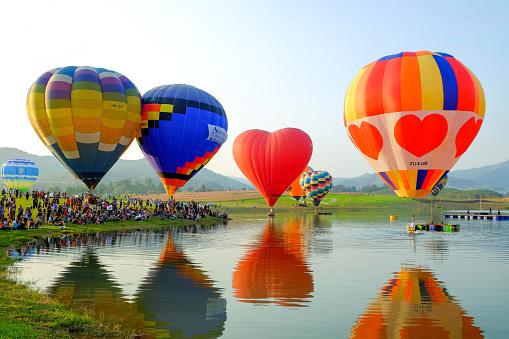 Chiang Rai-Thailand FEB 16 2017: People and tourists are watching hot-air balloon show at the Singha Park Chiang Rai International Balloon Fiesta, locate on Singha Park, Chiang Rai, Thailand