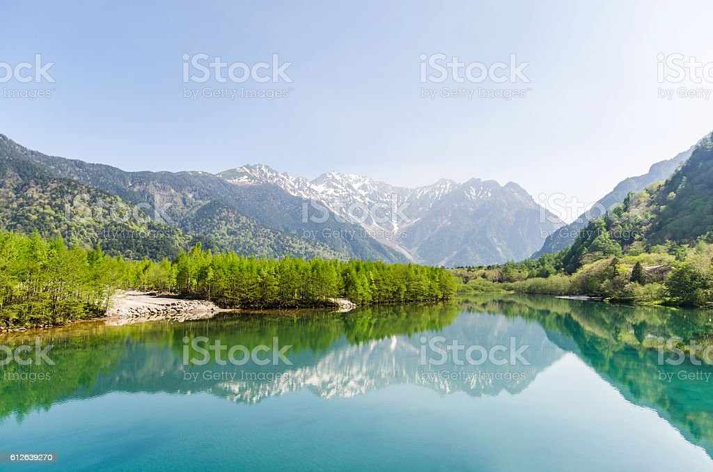 Hotaka mountain and taisho ike pond at kamikochi nagano japan stock photo