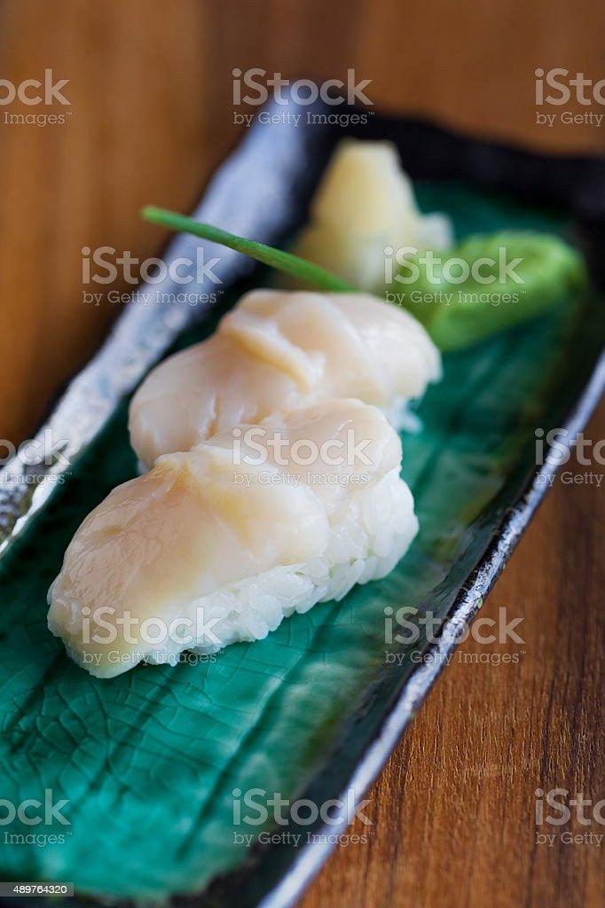 Hotate (scallop) nigiri sushi stock photo