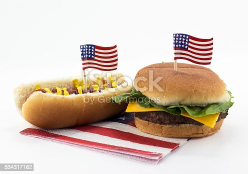 istock Hotdog and Hamburger on an American flag napkin and toothpick 534317162