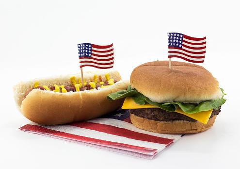 istock Hotdog and Hamburger on an American flag napkin and toothpick 534317162