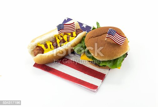 534317162 istock photo Hotdog and Hamburger on an American flag napkin and toothpick 534317196