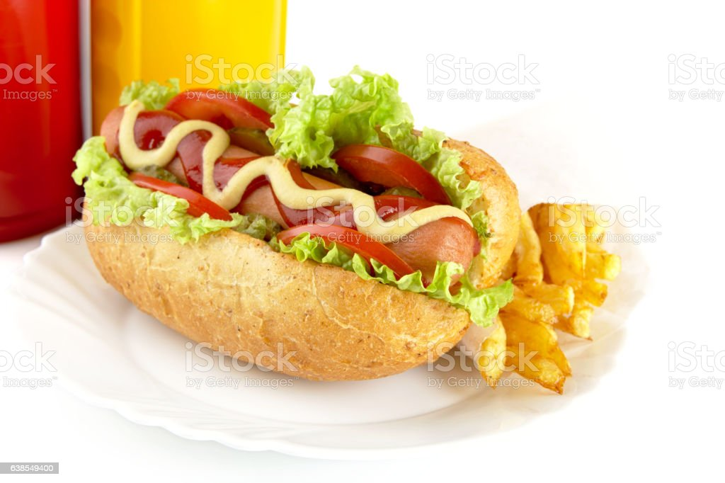 Hotdog on plate with french fries on white background stock photo