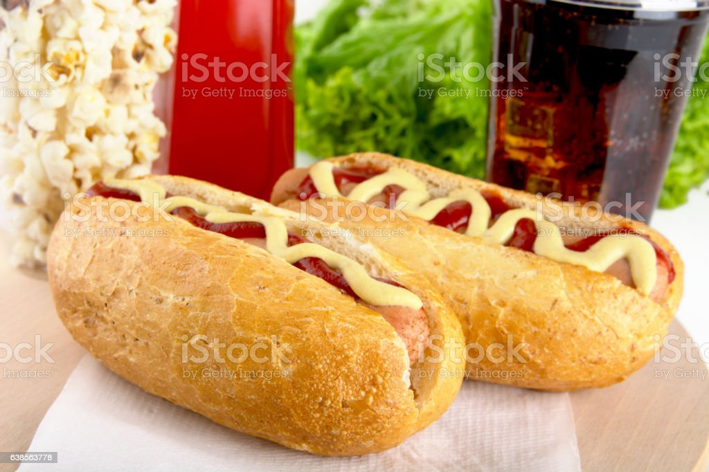 Hotdog with bottle of mustard,ketchup with drink cola,popcor stock photo