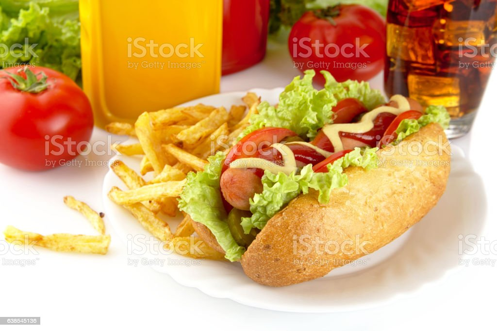 Hotdog with lettuce,tomatoes and cucumber on plate on white stock photo