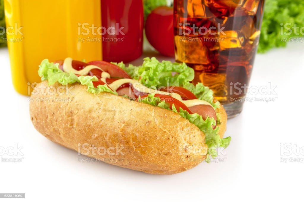 Hotdog with lettuce,tomatoes and cucumber on white background stock photo