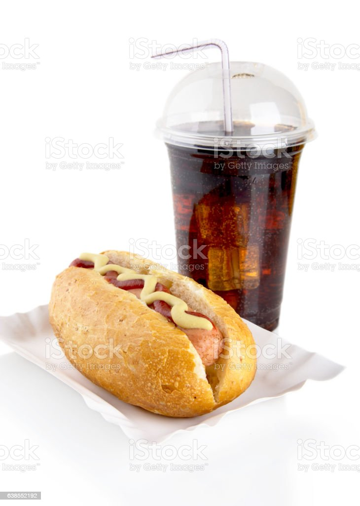 Hotdog with mustard, ketchup in tray with cola on white stock photo