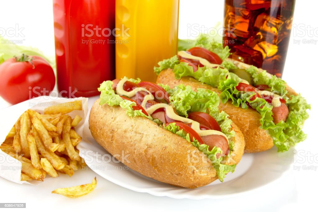 Hotdogs on plate with cola and french fries on white stock photo