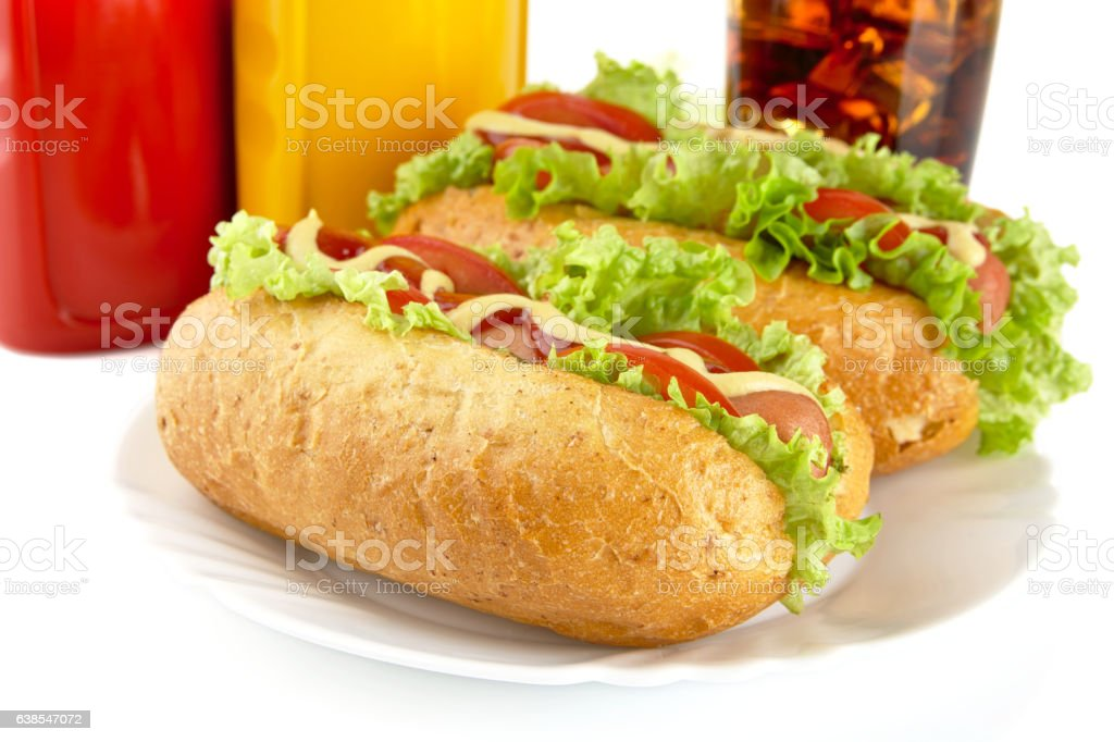 Hotdogs on plate with cola on white background stock photo