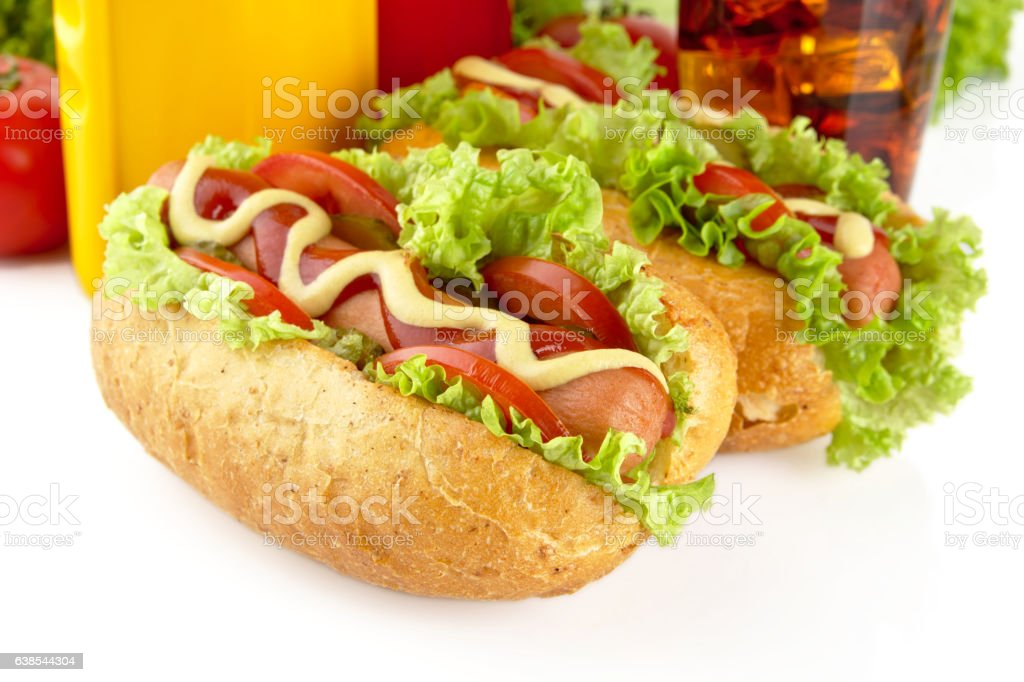 Hotdogs with lettuce,tomatoes and cucumber on white background stock photo
