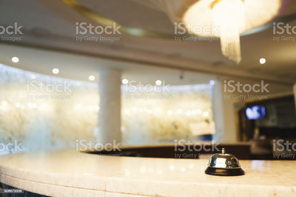 Hotel accommodation call bell on reception desk stock photo