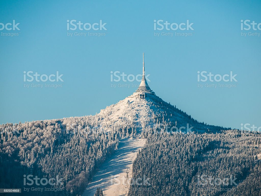 Hotel and transmitter Jested with ski slope stock photo