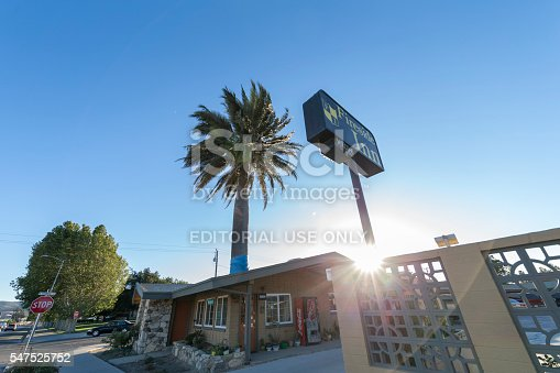 King City, California, USA - July 8, 2016: Close view a hotel at King City, California. A palm tree through the hotel office roof.