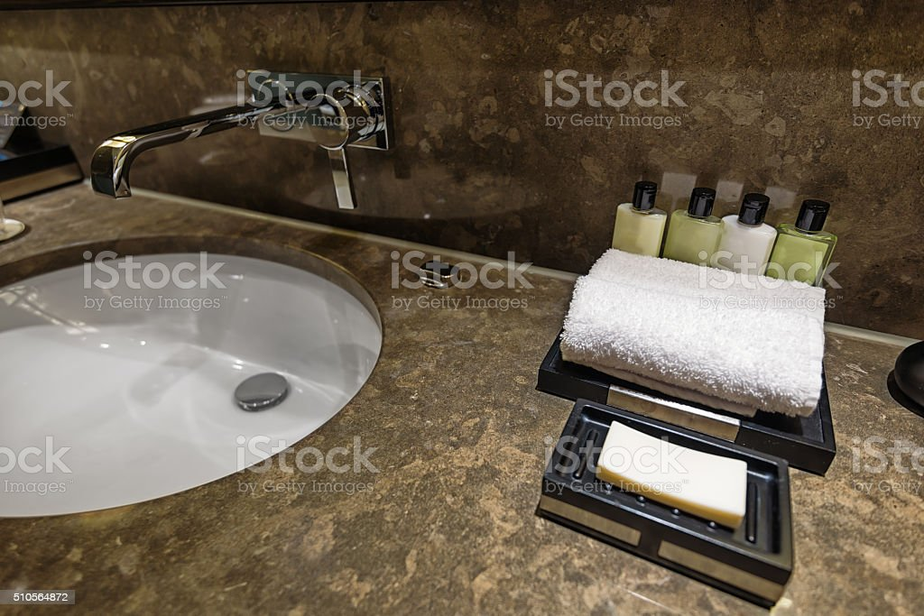 Hotel bathroom detail with soap, towel and shampoo stock photo