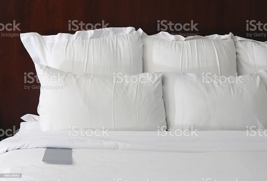 Hotel bed pillows with comment card royalty-free stock photo
