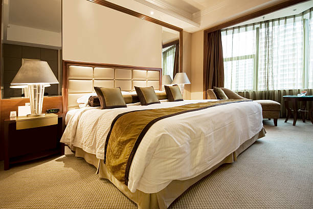 Hotel Bedroom luxury hotel roomBedrooms only; luxury hotel room stock pictures, royalty-free photos & images