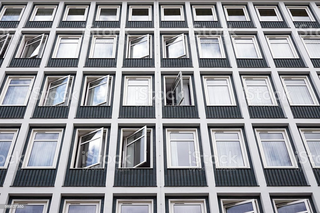 hotel building with many rows of windows stock photo