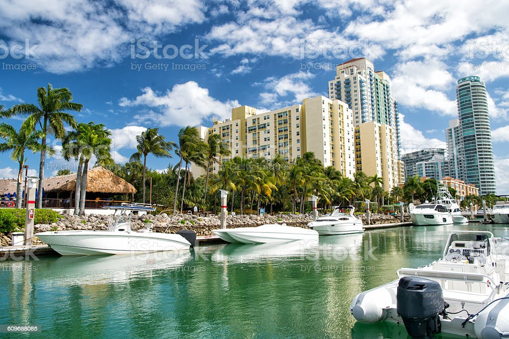 hotel buildings with yachts and palm trees stock photo
