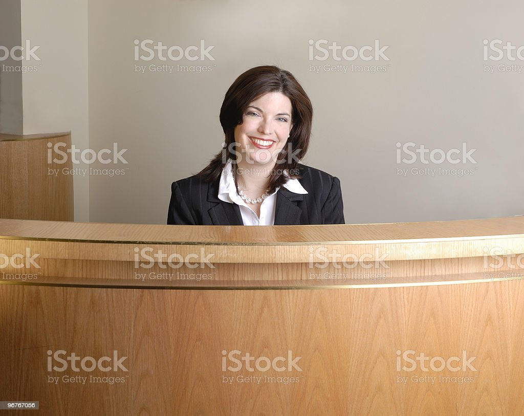 Hotel check in desk with assistant royalty-free stock photo
