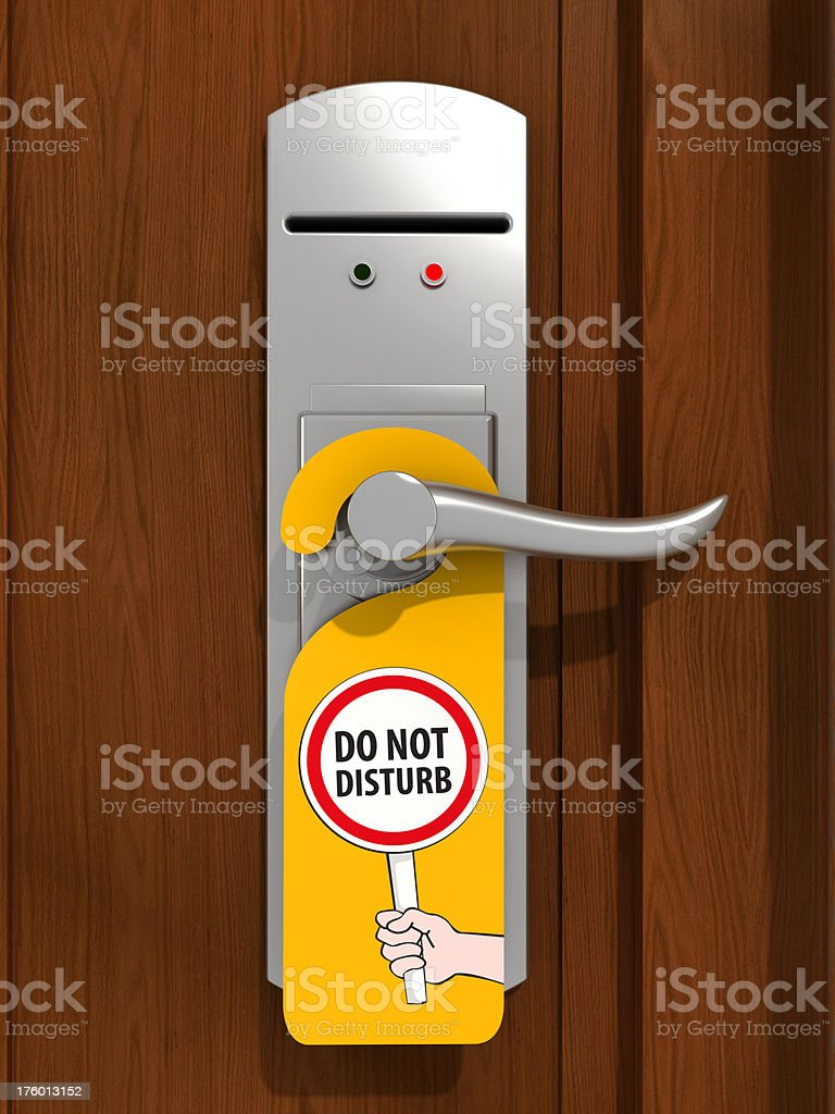 Hotel door with do not disturb sign royalty-free stock photo