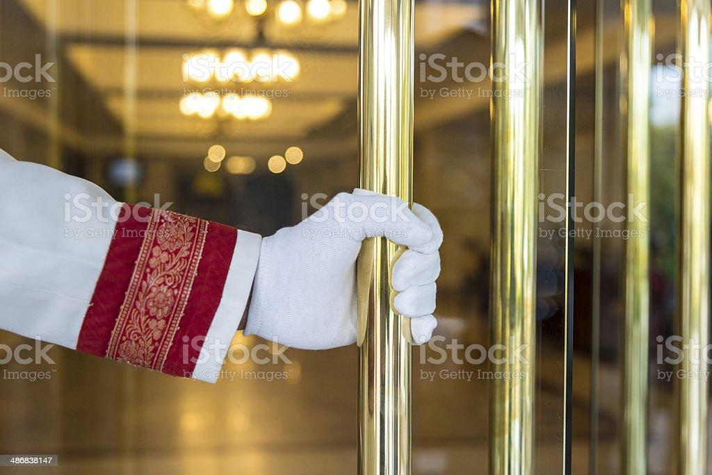 Hotel doorman customer service stock photo