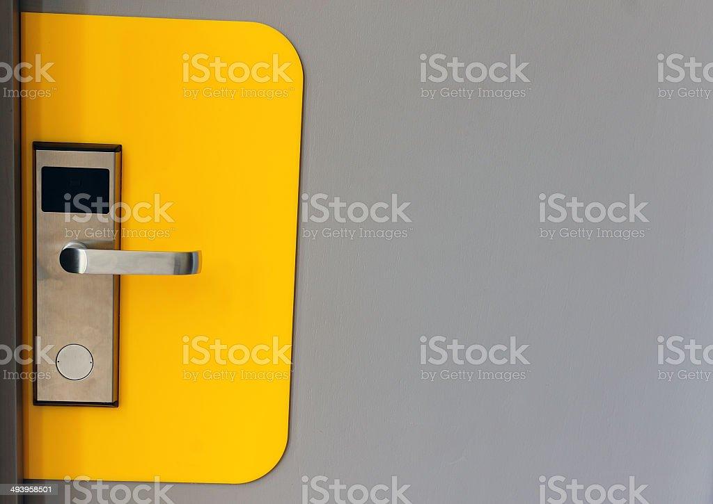 Hotel electronic lock on wooden door stock photo