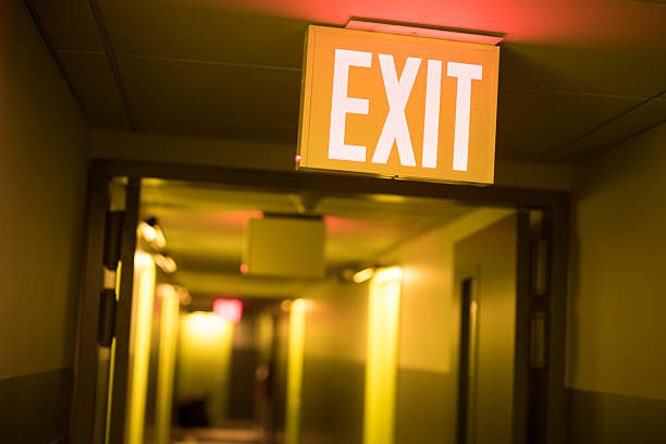 hotel exit sign - exit sign stock photos and pictures