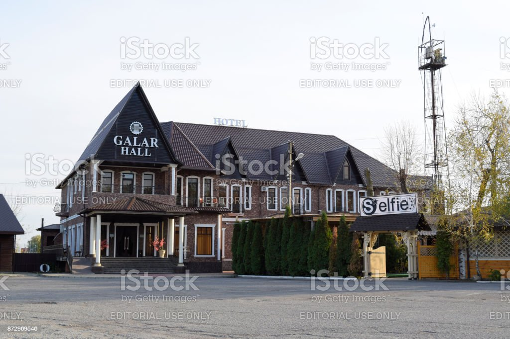 Hotel Galar Hall and a street cafe nearby. The area near the river, next to the pier. stock photo