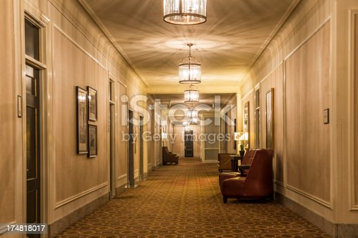 a hotel hallway / gets from the elevator / over to your room
