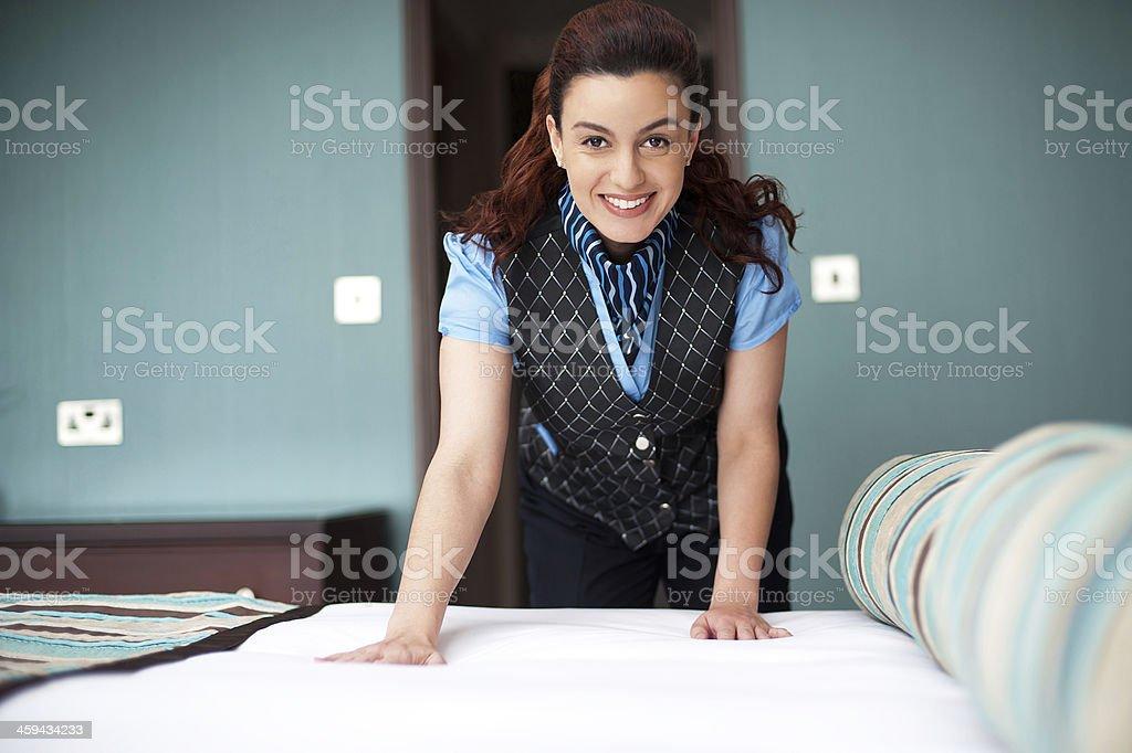 Hotel hostess working cheerfully stock photo