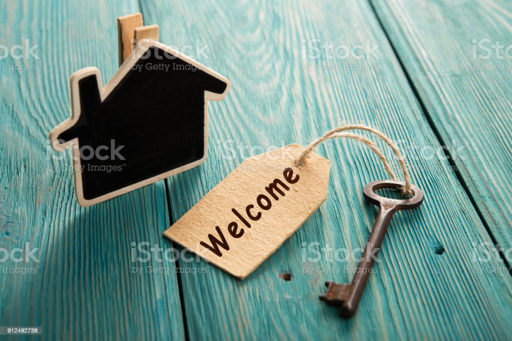 hotel key with welcome tag on the wooden background stock photo