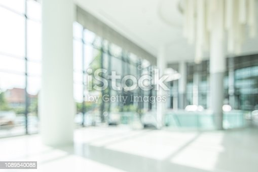istock Hotel lobby blur background banquet hall interior view of luxurious foyer of empty atrium space and entrance doors and glass wall 1089540088