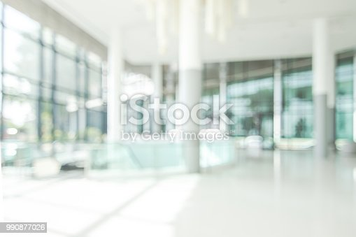 istock Hotel lobby blur background banquet hall interior view of luxurious foyer of empty atrium space and entrance doors and glass wall 990877026