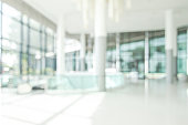 Hotel lobby blur background banquet hall interior view of luxurious foyer of empty atrium space and entrance doors and glass wall