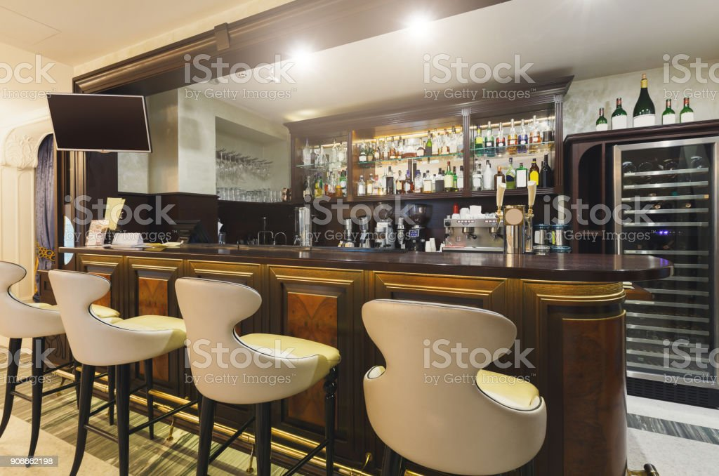 Hotel lounge bar with bottle shelfs and seats stock photo