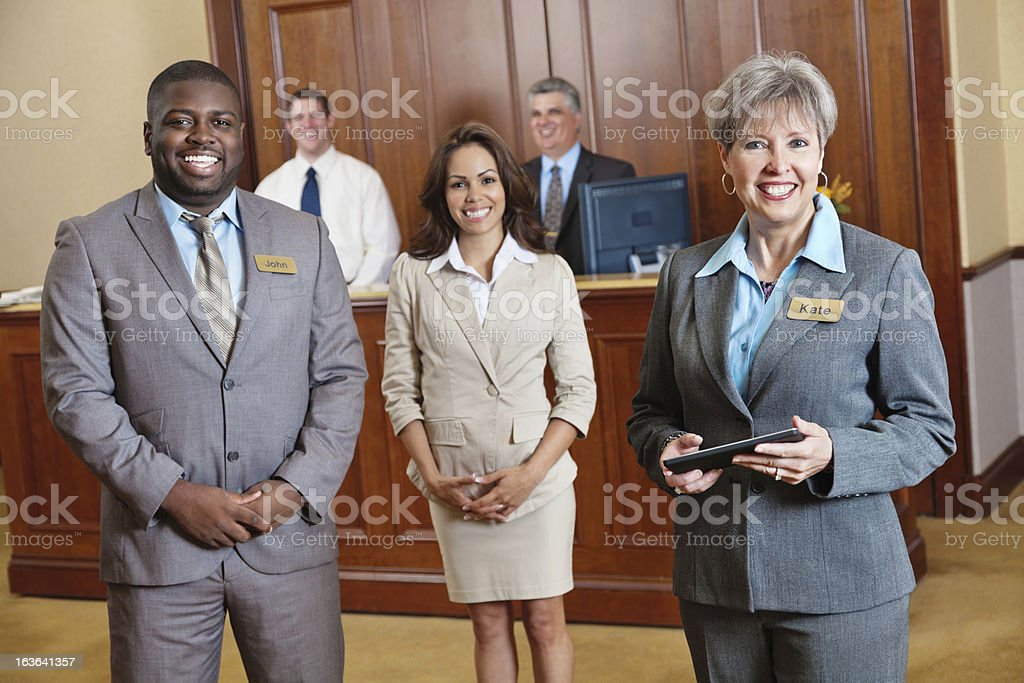 Hotel management and staff stock photo