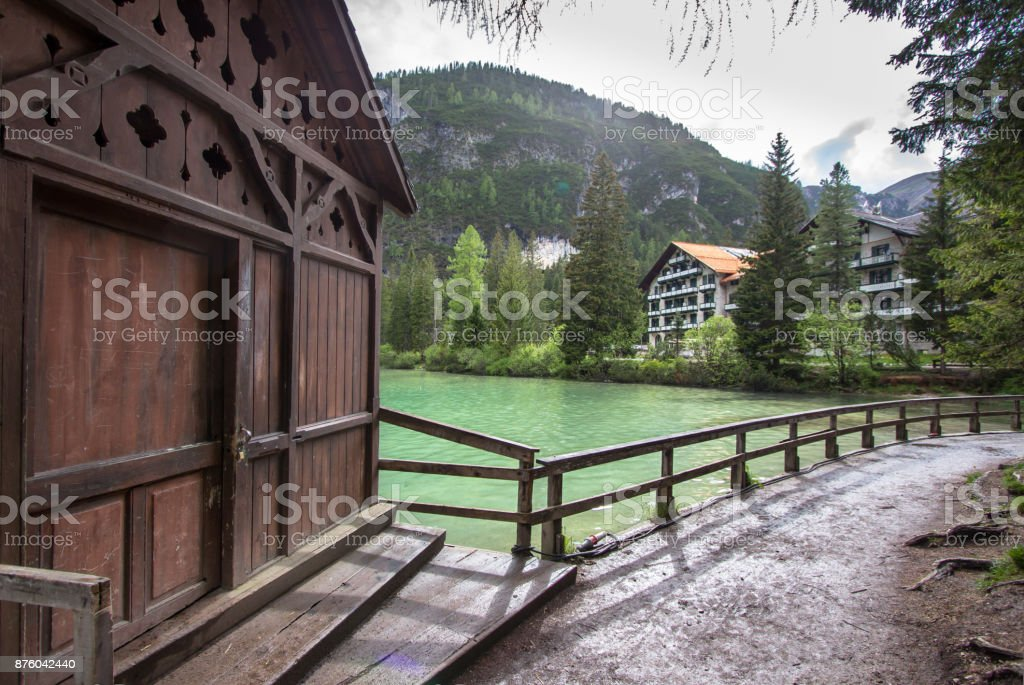 Hotel on Lake Braies in Dolomites, Italy stock photo