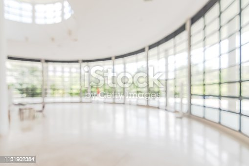 1156171081 istock photo Hotel or office building lobby blur background interior view toward reception hall, modern luxury white room space with blurry corridor and building glass wall window 1131902384
