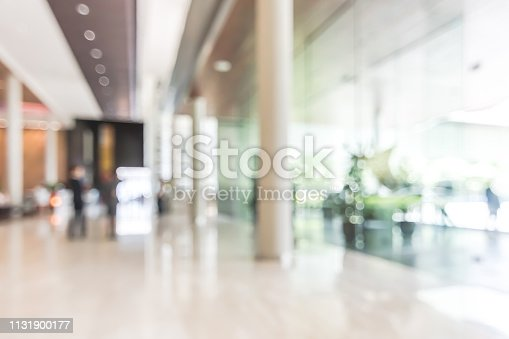 istock Hotel or office lobby blur background interior view toward reception hall, modern luxury white room space with blurry corridor and building glass wall window 1131900177