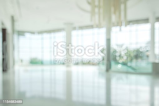1156171081 istock photo Hotel or office lobby blur background interior view toward reception hall, modern luxury white room space with blurry corridor and building glass wall window 1154683489