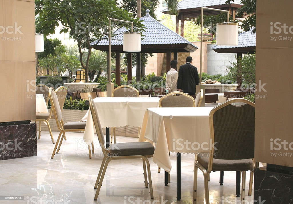 hotel outdoor cafe with garden in daytime royalty-free stock photo