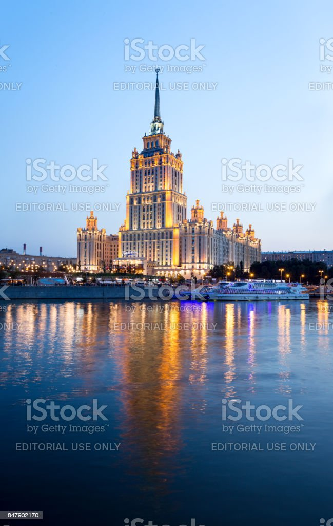 Hotel Radisson Royal (former 'Ukraine') symbols of Stalin and Soviet era. Colorful lights and reflections in the Moskva River in the evening stock photo