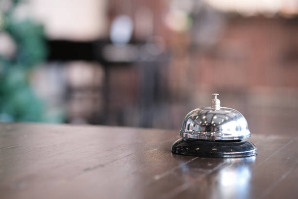 Hotel reception counter desk with service bell. stock photo